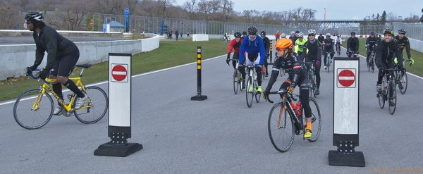 Circuit Gilles Villeneuve Formula 1 race track doubles as a cycling path in Montreal. Lex Albrecht professional cyclist and Georges Laraque NHL tough guy do a warm up lap before LEXvsLARAQUE2