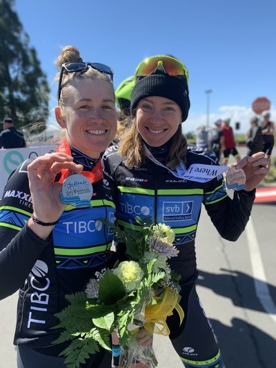 Lauren Stephens and Emily Newsom show their medals from the Redlands Bicycle Classic Stage 1 time trial.