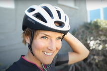 Professional athlete, Lex Albrecht wearing the Sena Bluetooth R1 cycling helmet