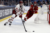 Cale Makar, left, of the Massachusetts Minutemen in action during the semifinals of the NCAA Men's Frozen Four on April 11, 2019 in Buffalo, New York. PHOTO BY ELSA/GETTY IMAGES/FILE