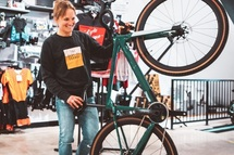 Professional cyclist and host of Preem TV, Lex Albrecht holds her new BMC Gravel bike, the URS 01 Two.