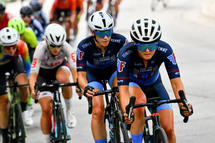 Lex Albrecht, professional cyclist, wearing SENA R1 Evo cycling helmet, on crit day with cycling Team Fearless Femme