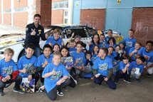 Alex Tagliani with students from the Kimberly/Beaches Alternative School