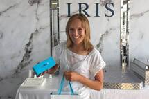 Professional athlete Lex Albrecht chooses her first pair of TrueBlue eye glasses from IRIS Visual Group