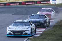 Alex Tagliani leads the pack in his Chevrolet Camaro at Mosport